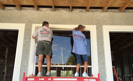 Employees Working on Glass Window in Casselberry, FL